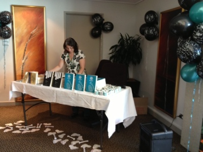 Alisa setting up the launch of One Small Step and The Bone Chime Song and Other Stories at Conflux